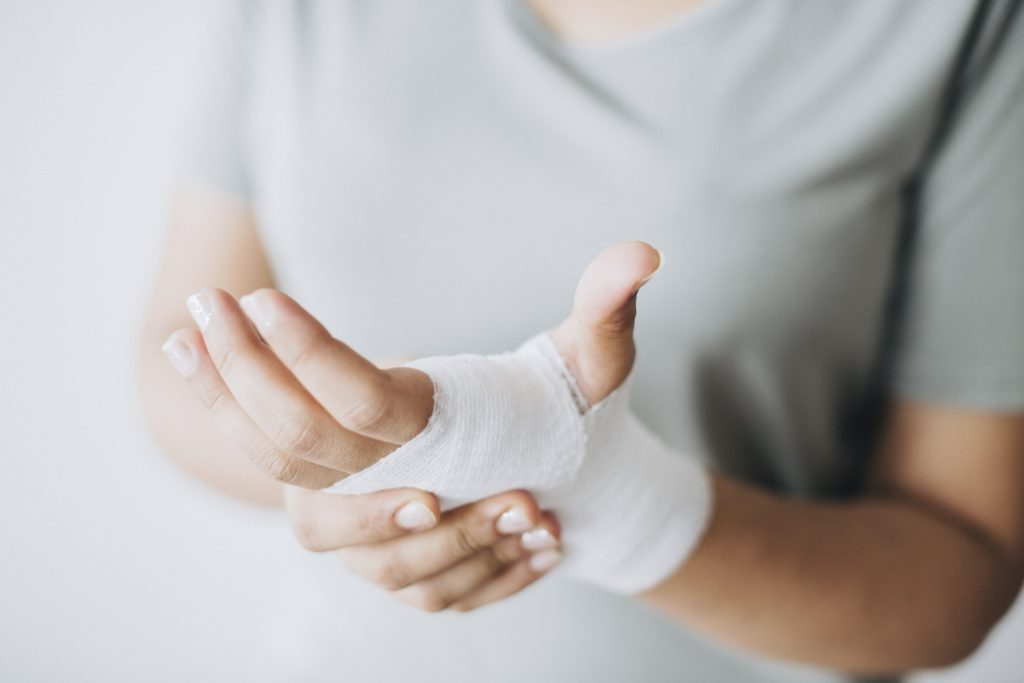 Person's hand wrapped in Gauze