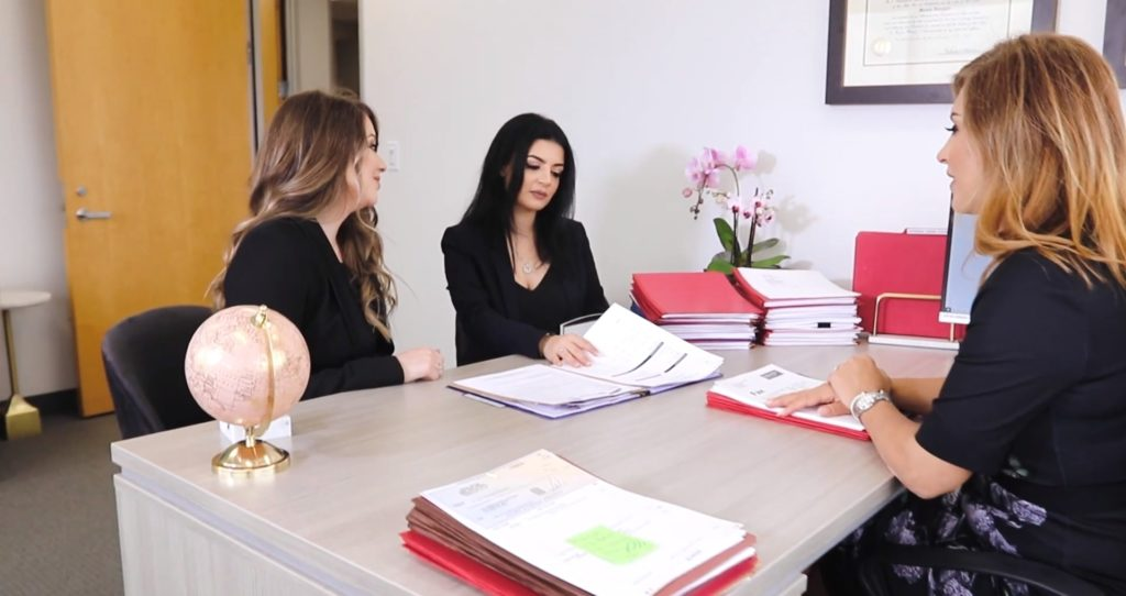Personal Injury Attorney, Mariam Kuregyan meeting with staff members